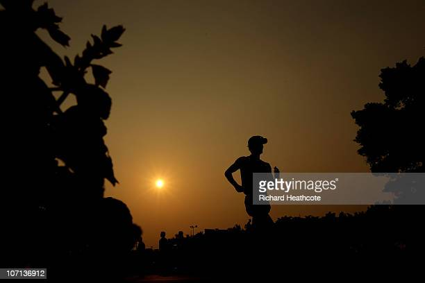 Tianfeng Si of China cools down as he competes in the men's 50km race walking final at Aoti Main Stadium during day thirteen of the 16th Asian Games...