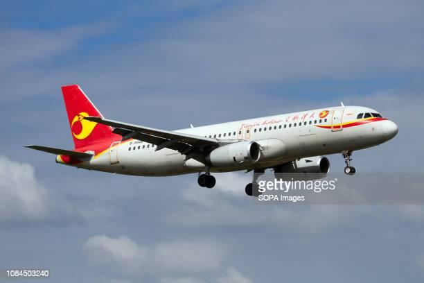 Tianjin Airlines Airbus 320 landing at Sanya Phoenix airport.