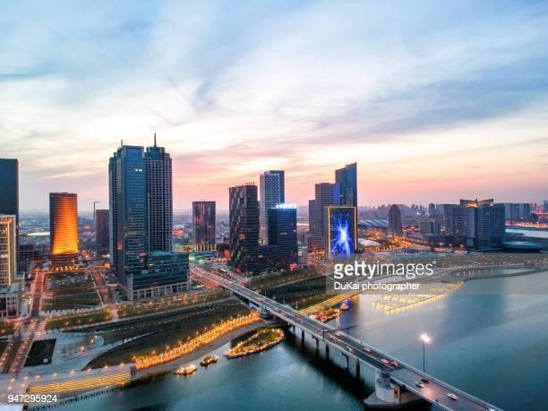 tianjin binhai financial district sunset - tianjin stock pictures, royalty-free photos & images