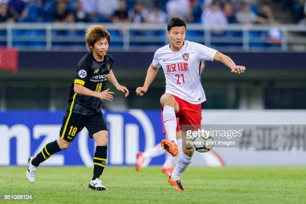 Tianjin Defender Kwon KyungWon in action against Kashiwa Reysol Forward Yusuke Segawa during the AFC Champions League 2018 Group E match between...