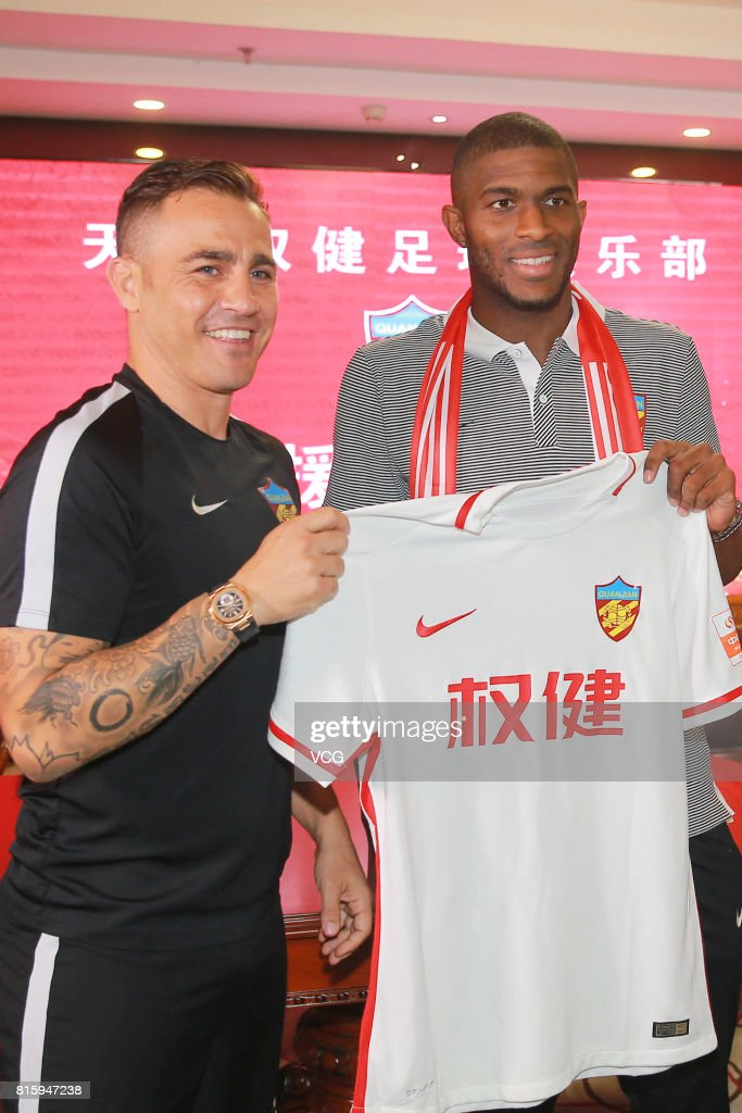Tianjin Quanjian manager Fabio Cannavaro (L) and French footballer Anthony Modeste pose at a press conference of Tianjin Quanjian FC on July 17, 2017 in Tianjin, China. Anthony Modeste plays for Tianjin Quanjian in the 2017 Chinese Super League (CSL) matches.