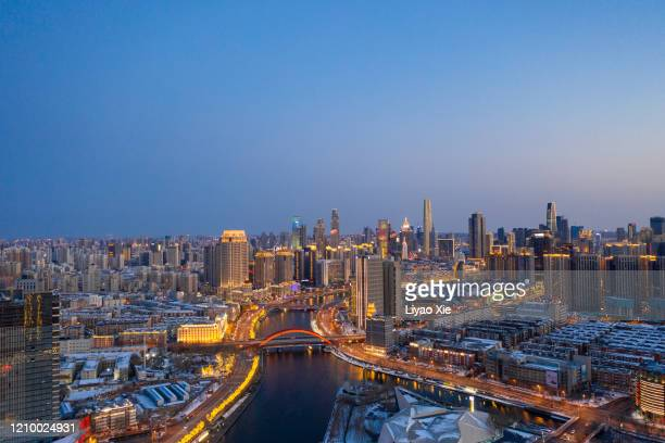 tianjin skyline after snow - liyao xie stock pictures, royalty-free photos & images