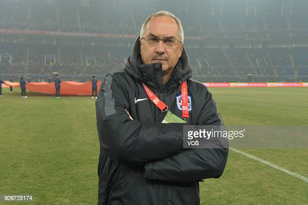 Tianjin Teda head coach Uli Stielike looks on during the 2018 Chinese Football Association Super League first round match between Tianjin Teda and...