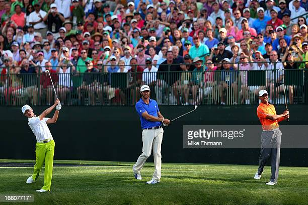 Tianlang Guan of China Dustin Johnson of the United States and Tiger Woods of the United States all hit a shot at the same time on the 16th hole...