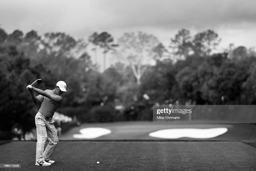 Tianlang Guan of China plays his tee shot on the fourth hole during the second round of the 2013 Masters Tournament at Augusta National Golf Club on April 12, 2013 in Augusta, Georgia.