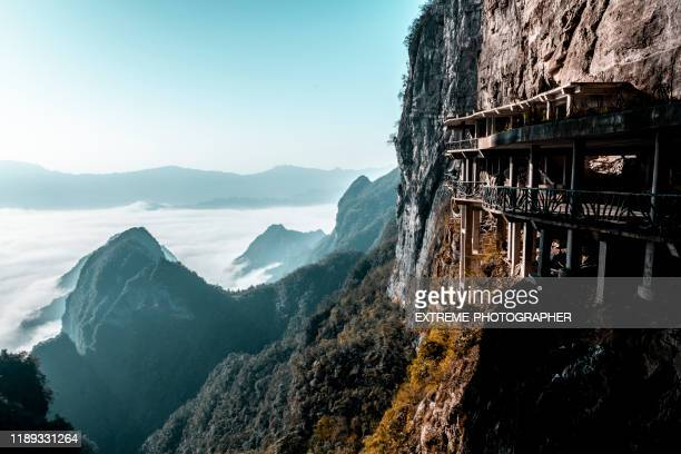 tianmen mountain (天门山) cliff walkway and stunning mountain peaks - tianmen stock pictures, royalty-free photos & images