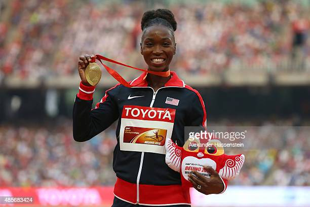 Tianna Bartoletta of the United States poses on the podium during the medal ceremony for the Women's Long Jump final during day eight of the 15th...