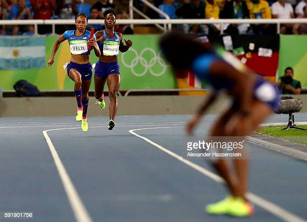 Tianna Bartoletta passes the baton to Allyson Felix of the United States during the round one Women's 4 x 100m Relay ReRun on Day 13 of the Rio 2016...