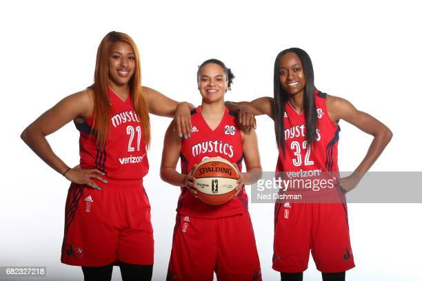 Tianna Hawkins Kristi Toliver and Daniel Ochefu of the Washington Mystics poses for a portrait during Media Day on May 11 2017 at Verizon Center in...