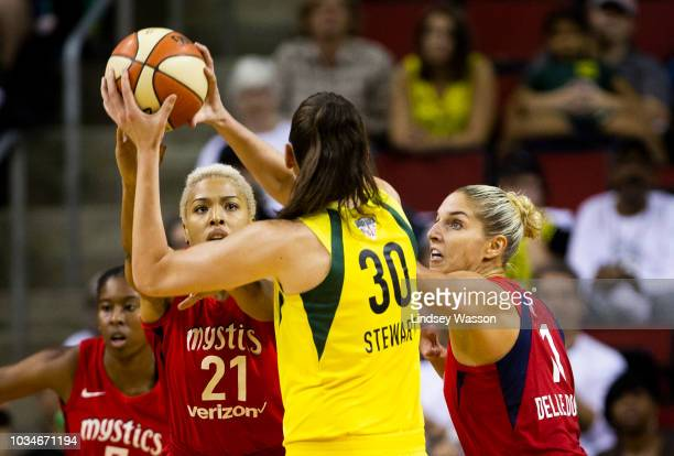 Tianna Hawkins of the Washington Mystics and Elena Delle Donne defend against Breanna Stewart of the Seattle Storm during the first half of Game 2 of...