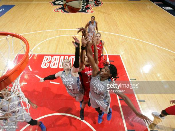 Tianna Hawkins of the Washington Mystics goes for the rebound against Lindsay Whalen and Sylvia Fowles of the Minnesota Lynx in Game Three of the...