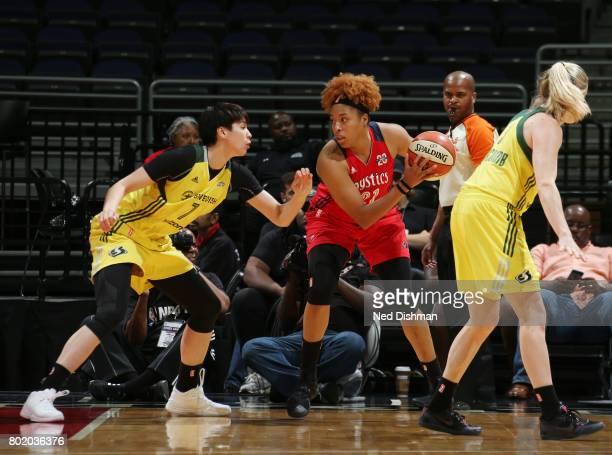 Tianna Hawkins of the Washington Mystics handles the ball against Ramu Tokashiki of the Seattle Storm on June 27 2017 at the Verizon Center in...