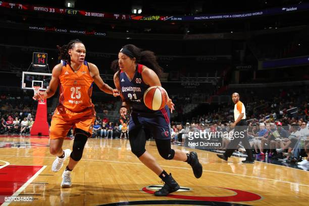 Tianna Hawkins of the Washington Mystics handles the ball against Monique Currie of the Phoenix Mercury on August 6 2017 at the Verizon Center in...