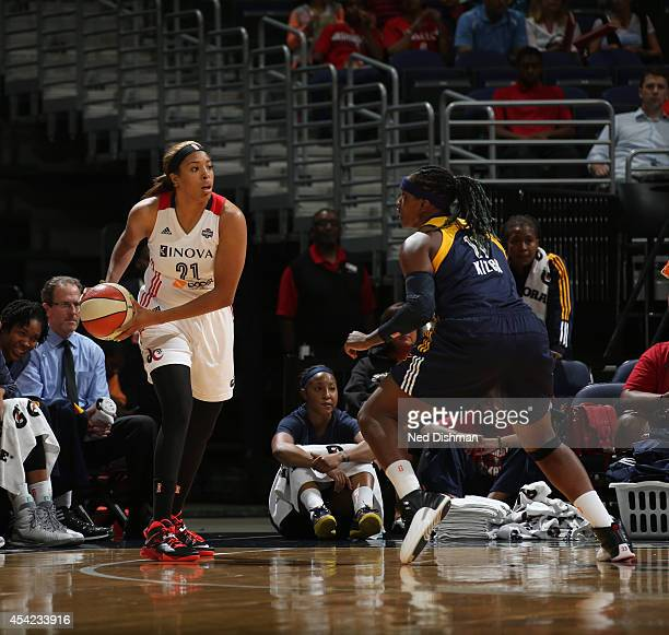 Tianna Hawkins of the Washington Mystics looks to pass the ball against Lynetta Kizer of the Indiana Fever in Game Two of the Eastern Conference...