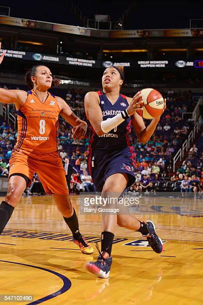Tianna Hawkins of the Washington Mystics moves the ball against Mistie Bass of the Phoenix Mercury on July 13 2016 at Talking Stick Resort Arena in...