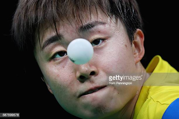 Tianwei Feng of Singapore competes against Ai Fukuhara of Japan during the Women's Singles Quarterfinal 3 Table Tennis on Day 4 of the Rio 2016...