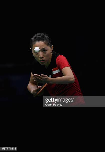 Tianwei Feng of Singapore competes against Ai Fukuhara of Japan during the Women's Singles Quarterfinal 4 Table Tennis on Day 4 of the Rio 2016...