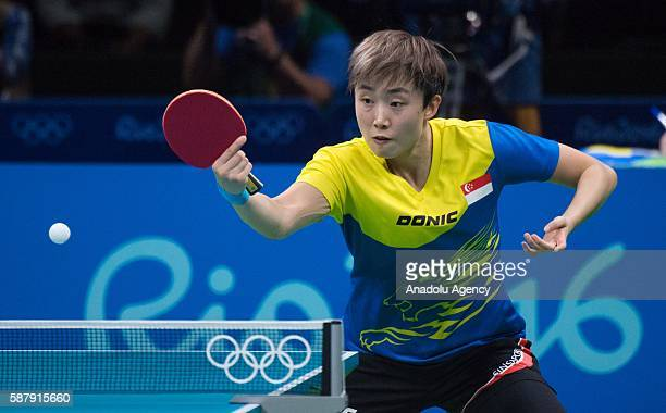 Tianwei Feng of Singapore competes against Ai Fukuhara of Japan during the Women's Singles Quarter final on fourth day of the Rio 2016 Olympic Games...