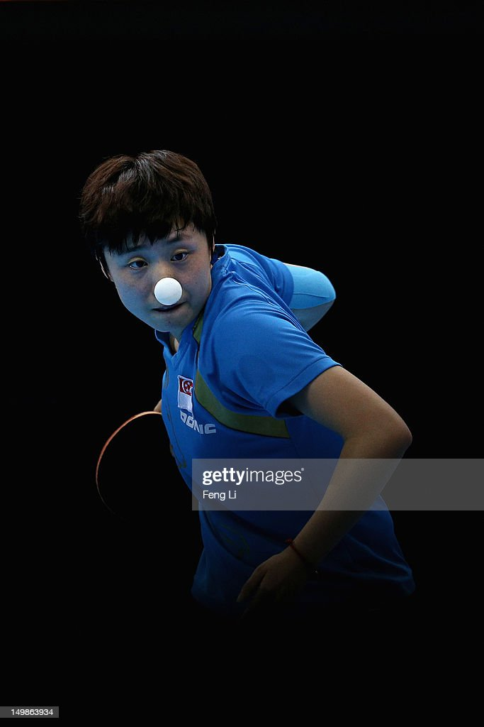 Tianwei Feng of Singapore competes during Women's Team Table Tennis semifinal match against team of Japan on Day 9 of the London 2012 Olympic Games at ExCeL on August 5, 2012 in London, England.