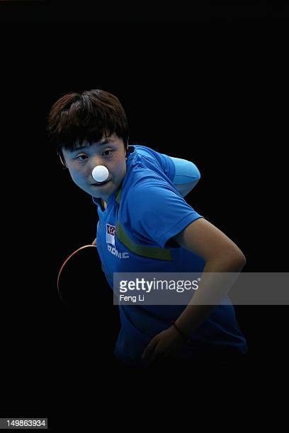 Tianwei Feng of Singapore competes during Women's Team Table Tennis semifinal match against team of Japan on Day 9 of the London 2012 Olympic Games...