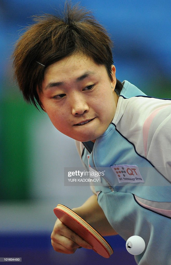 Tianwei Feng of Singapore returns a serv