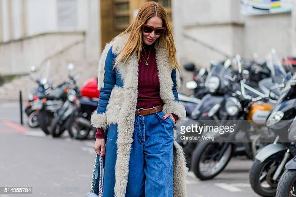 Tiany Kiriloff is wearing a shearling fur coat and denim jeans outside Ellery during the Paris Fashion Week Womenswear Fall/Winter 2016/2017 on March...