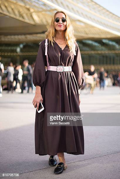 Tiany Kiriloff poses wearing an Other Stories dress and Gucci shoes before the Koche show at the Passage de la Canopee during Paris Fashion Week...
