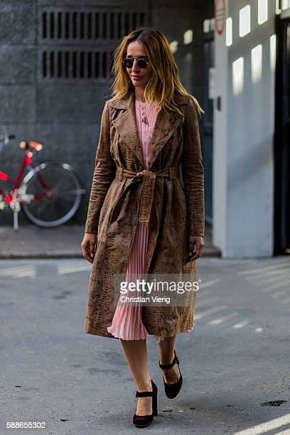Tiany Kiriloff wearing a brown coat and pink dress outside Baum und Pferdgarten during the second day of the Copenhagen Fashion Week Spring/Summer...