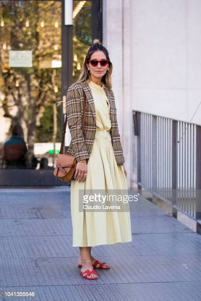 Tiany Kiriloff wearing yellow dress checked blazer Loewe bag and Hermes sandals is seen before the Dries Van Noten show on September 26 2018 in Paris...