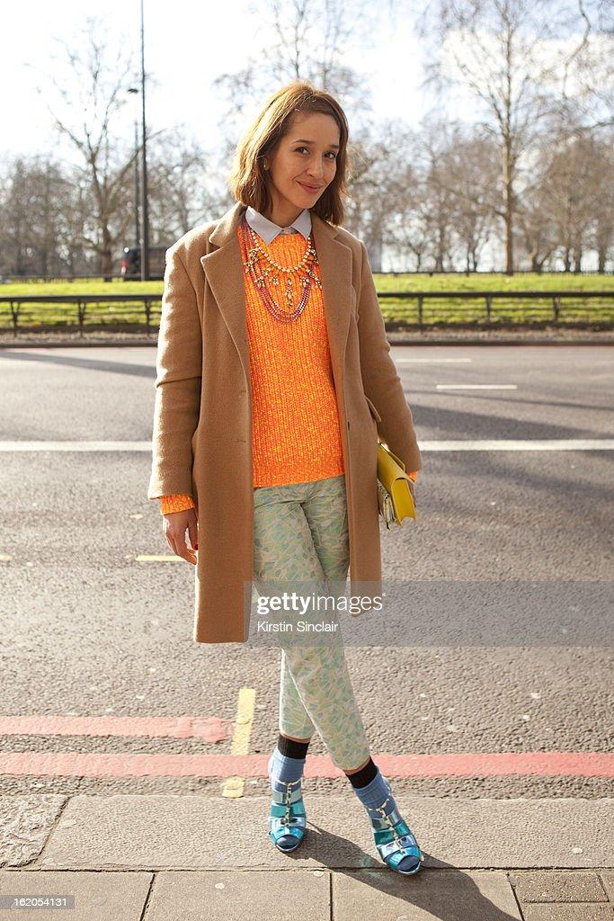 Tiany Kiriloff wears Nicholas Kirkwood shoes, Jill Sanders jacket and Kenzo sweater on day 3 of London Womens Fashion Week Autumn/Winter 2013 on February 17, 2013 in London, England.
