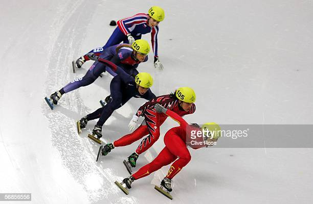 Tianyu Fu of China Anouk LeblancBoucher of Canada Sarah Lindsay of Great Britain Allison Baver of USA and Katerina Novotna of Czech Republic skate in...