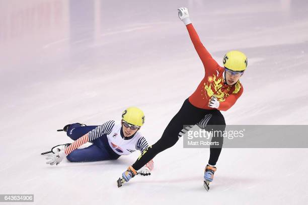 Tianyu Han of China and Seyeong Park of Korea compete in the Short Track Speed Skating men's 5000 metre final on day five of the 2017 Sapporo Asian...