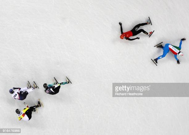 Tianyu Han of China and Yuri Confortola of Italy crash during the Men's 1500m Short Track Speed Skating qualifying on day one of the PyeongChang 2018...