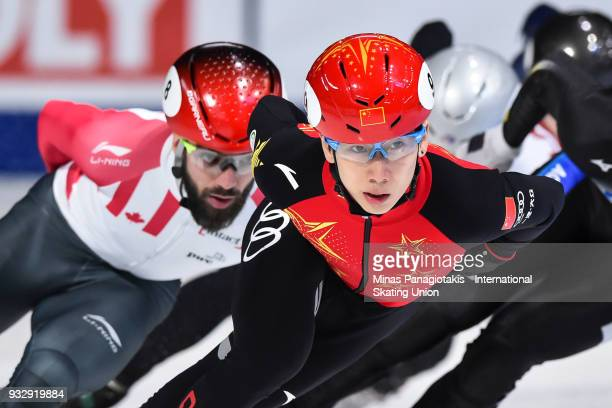 Tianyu Han of China competes in the men's 1000 meter heat during the World Short Track Speed Skating Championships at Maurice Richard Arena on March...