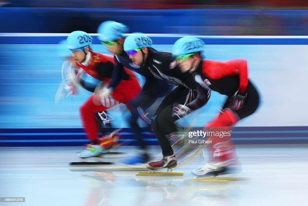 Tianyu Han of China, Han-Bin Lee of Korea, Chris Creveling of the United States and Charle Cournoyer of Canada during the Men's 1000m Quarterfinal Short Track Speed Skating on day 8 of the Sochi 2014 Winter Olympics at the Iceberg Skating Palace on February 15, 2014 in Sochi, Russia.