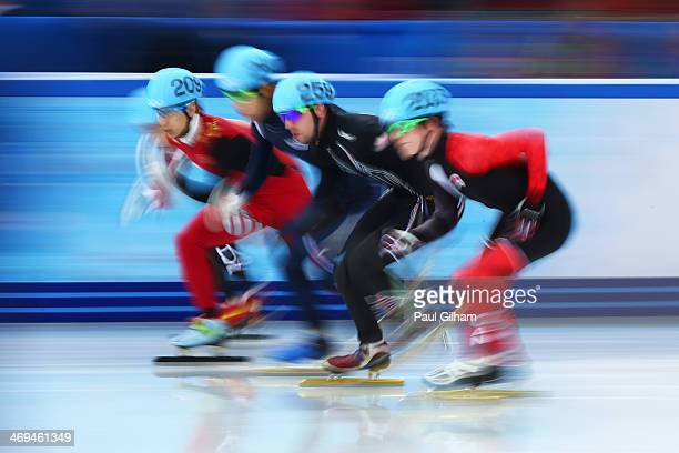 Tianyu Han of China HanBin Lee of Korea Chris Creveling of the United States and Charle Cournoyer of Canada during the Men's 1000m Quarterfinal Short...