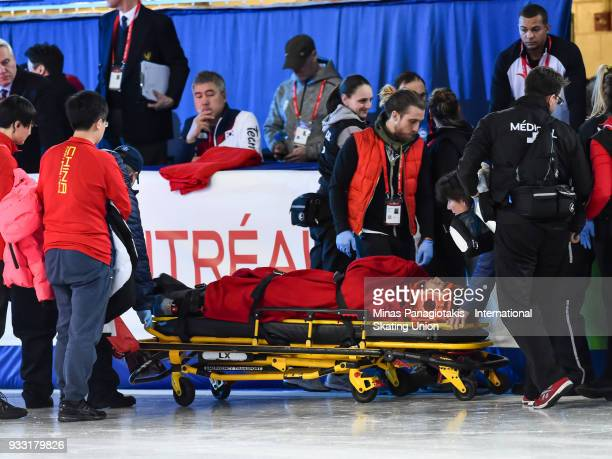 Tianyu Han of China is placed on a stretcher after crashing hard into the padding in the men's 1500 meter B Final during the World Short Track Speed...