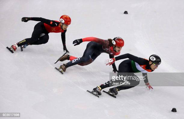 Tianyu Han of China Samuel Girard of Canada and Shaolin Sandor Liu of Hungary during the Short Track Speed Skating Men's 5000m Relay Final A on day...