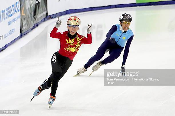Tianyu Han of the People's Republic of China reacts after beating Nurbergen Zhumagaziyev of Kazakhstan in the Men's 5000 meter relay during the ISU...