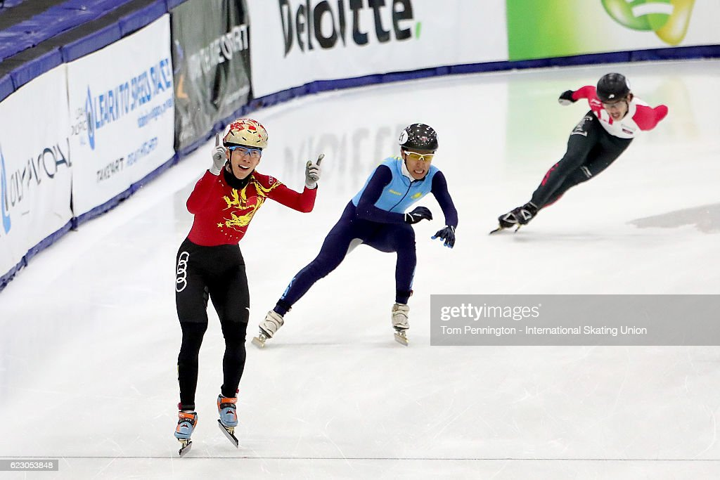 Tianyu Han of the People's Republic of China reacts after beating Nurbergen Zhumagaziyev of Kazakhstan in the Men's 5000 meter relay during the ISU World Cup Short Track Speed Skating event on November 13, 2016 in Salt Lake City, Utah.