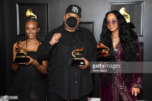 """Tiara Thomas, Jeff Robinson, and H.E.R., winners of Song of the Year for """"I Can't Breathe"""", poses in the media room during the 63rd Annual GRAMMY..."""