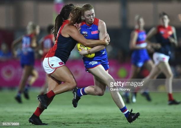 Tiarna Ernst of the Bulldogs is tackled by Richelle Cranston of the Demons during the round seven AFLW match between the Western Bulldogs and the...