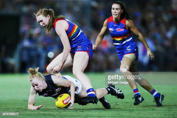 Tiarna Ernst of the Bulldogs tackles Kate Shierlaw of the Blues during the round four AFLW match between the Western Bulldogs and the Carlton Blues...