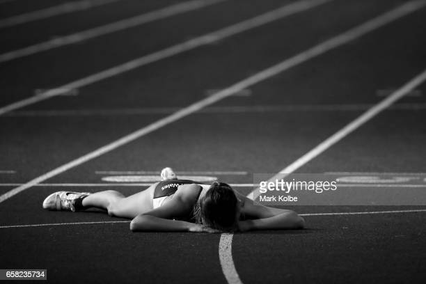 Tiarna Mason of NSW lies on the track after competing in the womens 200m under 20s final on day two of the 2017 Australian Athletics Championships at...