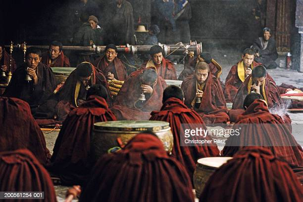 Tibet, Lhasa, monks chanting at Jokhang temple