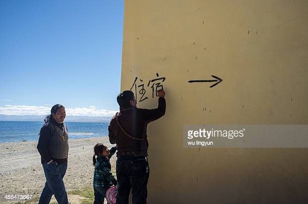 Tibet man wrote 'Stay' in Chinese on the wall of his hotel by the Lake Manasarovar in Ngari western Tibet