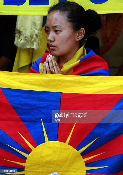 Tibetan activists in exile offer condolence prayers to Tibetans who died during an alleged crackdown by Chinese troops in Tibet at the West...
