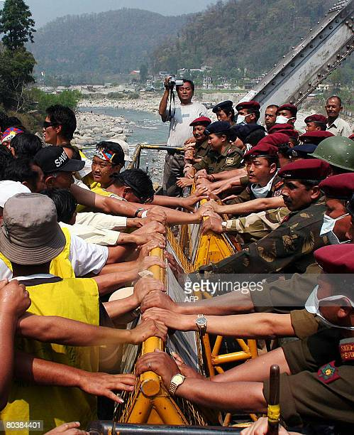 Tibetan activists in exile shout antiChinese slogans at the West BengalSikkim interstate border in Rangpo on March 26 2008 as police deny them entry...