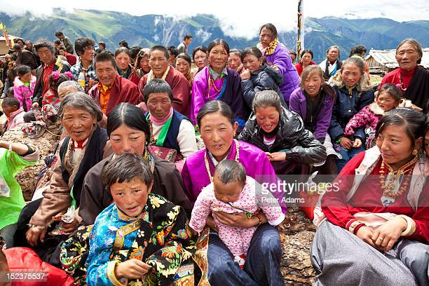tibetan audience at buddhist monastery, china - peter adams stock pictures, royalty-free photos & images