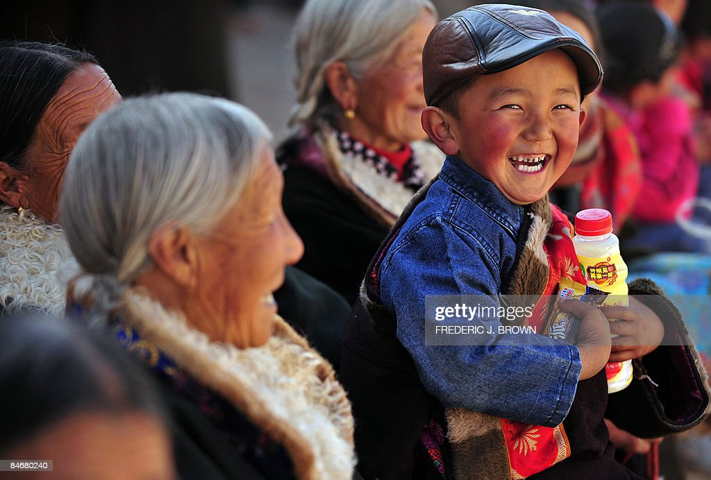 A Tibetan boy smiles after receiving gif : News Photo